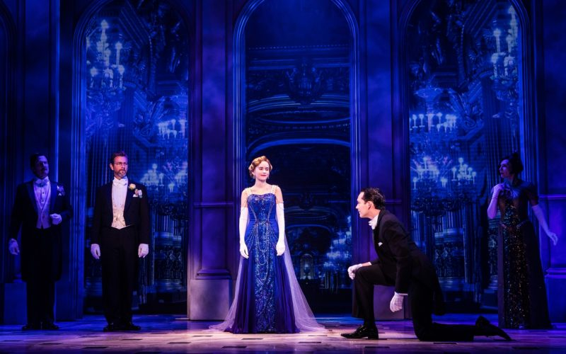 Anastasia arrives to the opera in her blue gown.
