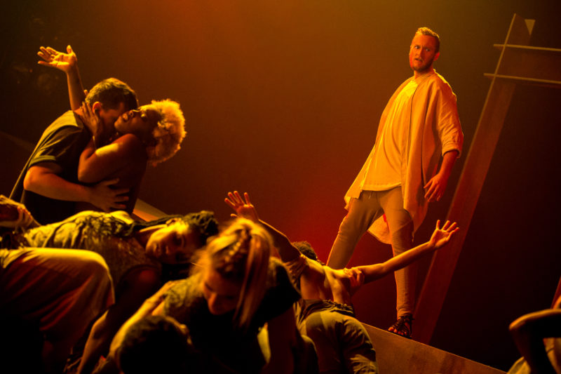An outraged Jesus looks upon a crowd simulating lustful acts